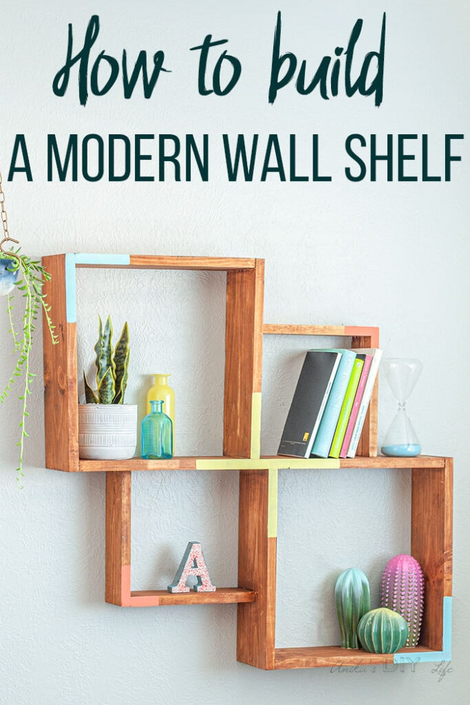 A DIY Modern Wall Shelf on the wall with decor and text overlay
