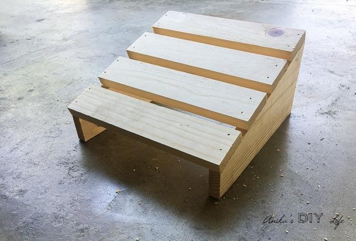 Completed DIY footrest on garage floor