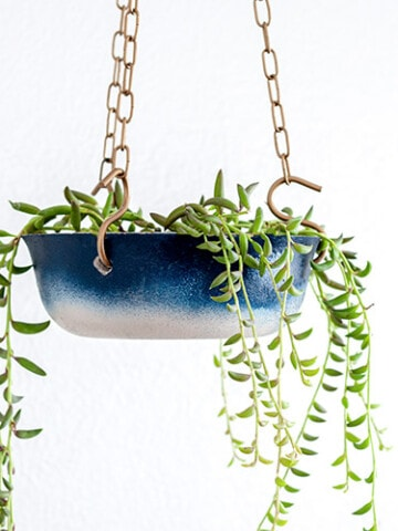 Learn how to make a DIY hanging concrete planter and give it a pretty ombre effect using Rust-Oleum spray paint. It makes the perfect hanging planter for any room.