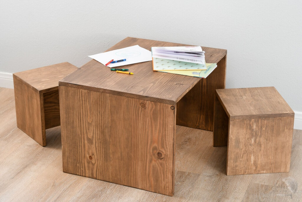 simple toddler table and chair set with books on it