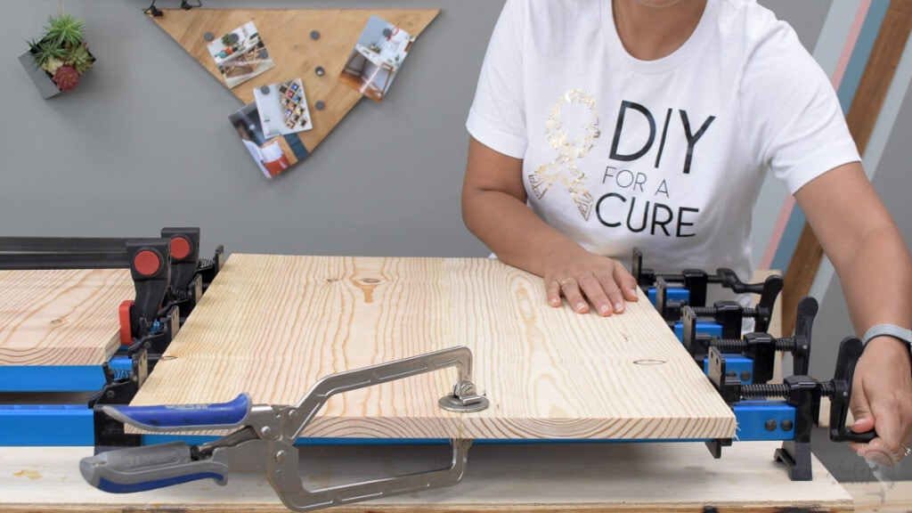 woman glueing up boards