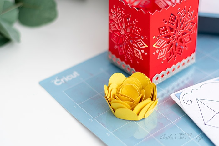 close up of paper flower and luminary made usig Cricut