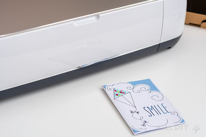 Simple Smile card in front of Cricut Maker machine