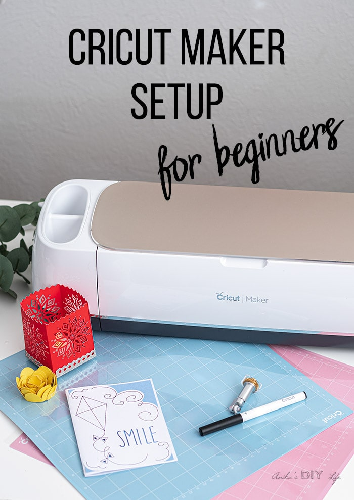 Cricut maker and a few paper crafts on table