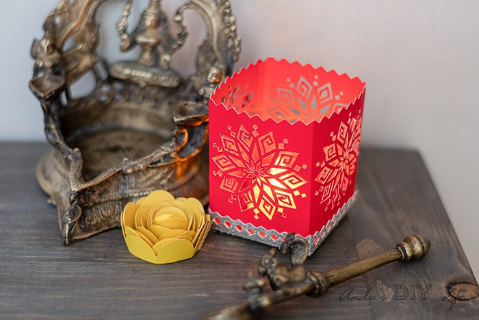 DIY Diwali luminary made on the Cricut on table with other traditional decor