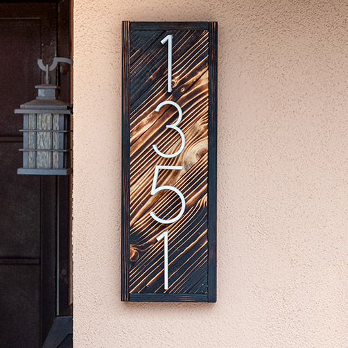How to make a DIY house number sign. Add a unique look using a fun wood-burning technique and increase curb appeal.