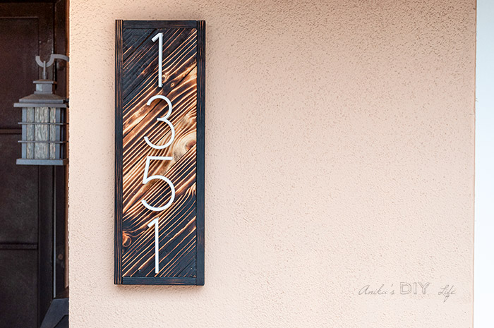 DIY house number sign with gradient wood burning on the wall