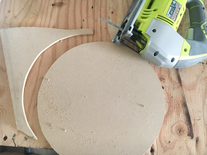 Cutting the clock face for the DIY wood clock.