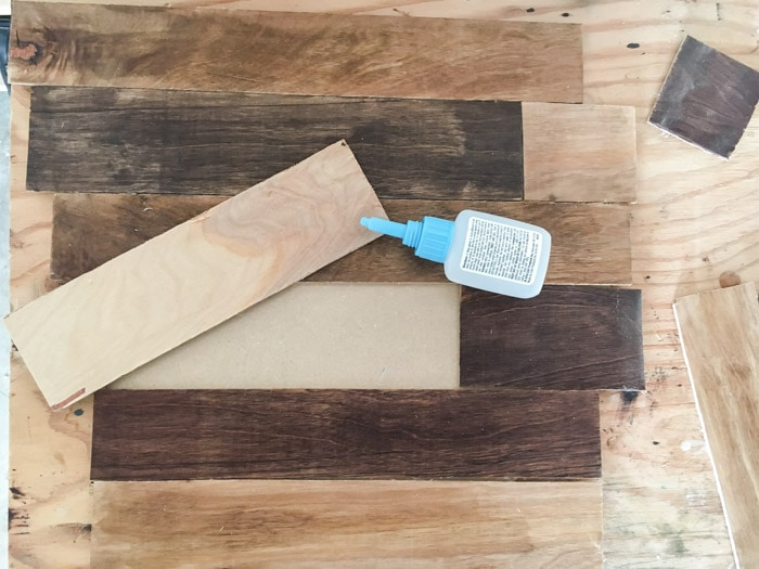 attaching strips to make the DIY wood clock