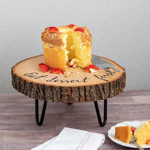Learn how to make an easy customized DIY wood slice cake stand. The hairpin legs add rustic farmhouse charm to the gorgeous wooden cake stand. Perfect for any occasion.