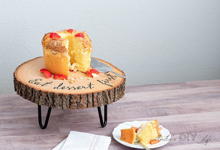 DIY wood slice cake stand on table with cake