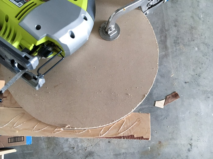 cutting off the overhanging pieces of plywood on the DIY wood wall clock