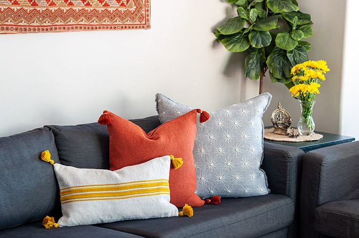 living room couch with colorful pillows
