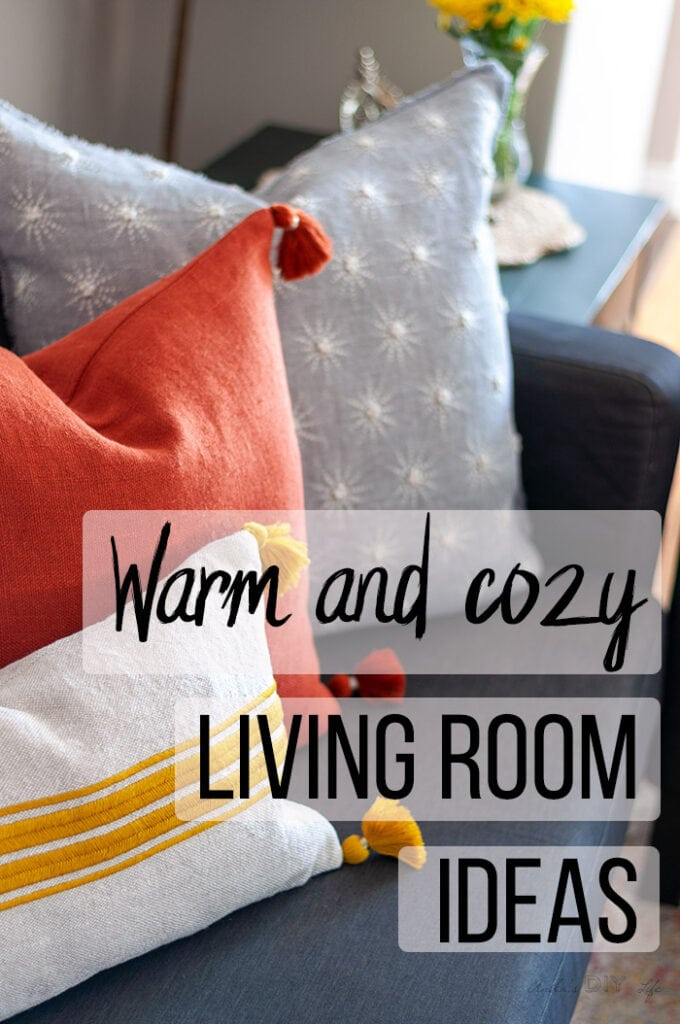 close up of pillows in a warm and cozy living room with text overlay