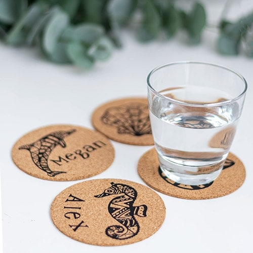 How to make personalized cork coasters using iron on or heat transfer vinyl. This is a quick and easy DIY hostess gift idea using a Cricut machine.