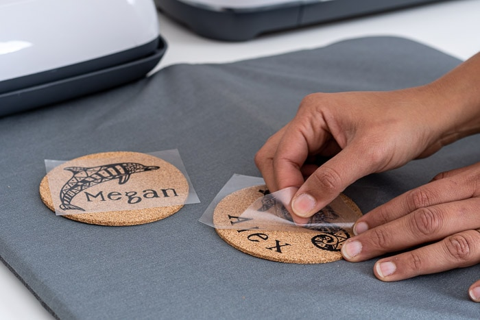Peeling off backing to reveal design on cork coasters