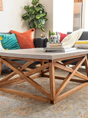 Learn how to build a Serena & Lily inspired DIY square coffee table with angled X-legs. This budget-friendly DIY uses a trick to mimic the concrete top too!