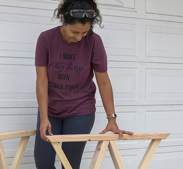 Woman with Woodworking tshirt and project