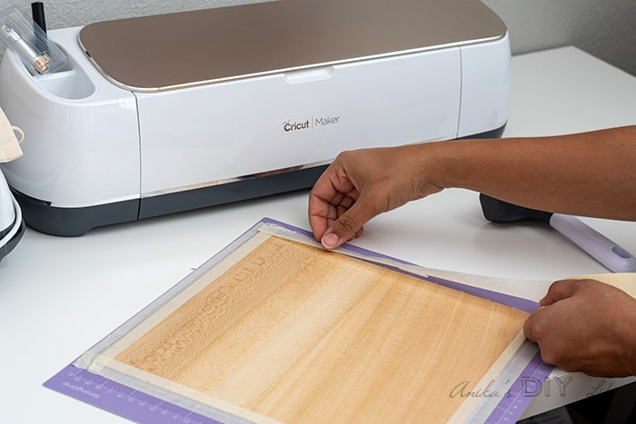 Attaching basswood to Cricut Maker mat to cut