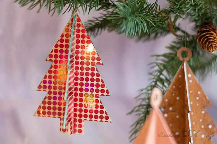DIY wooden Christmas ornament covered in holographic vinyl.