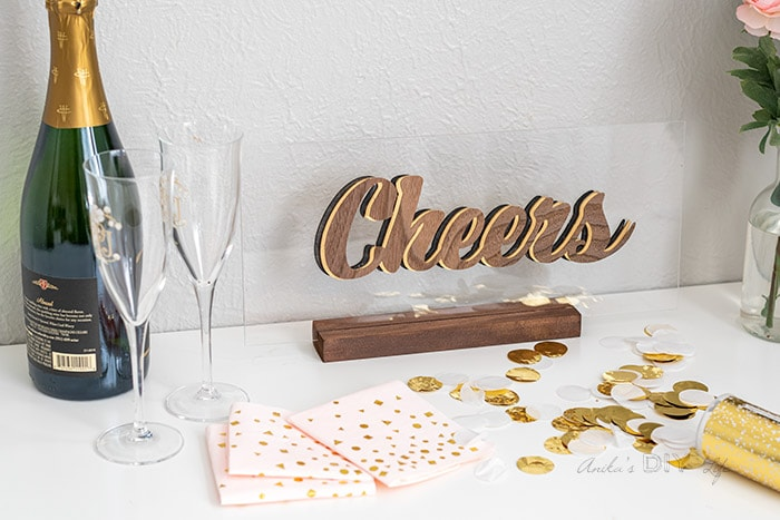 Cheers sign on table with champaign and napkins