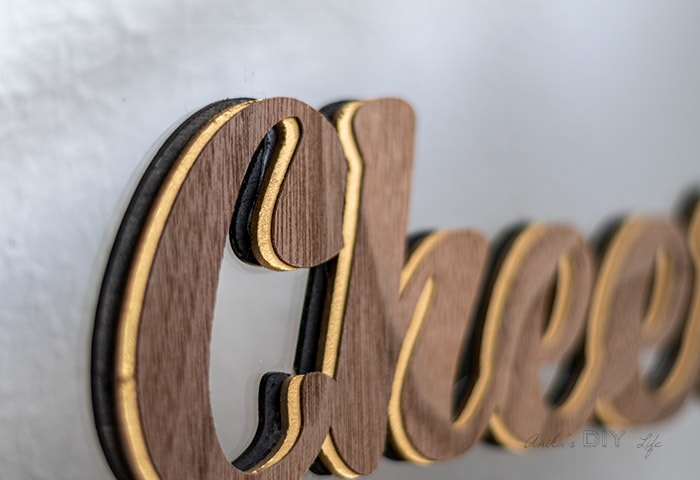 close up of Cheers sign with layers