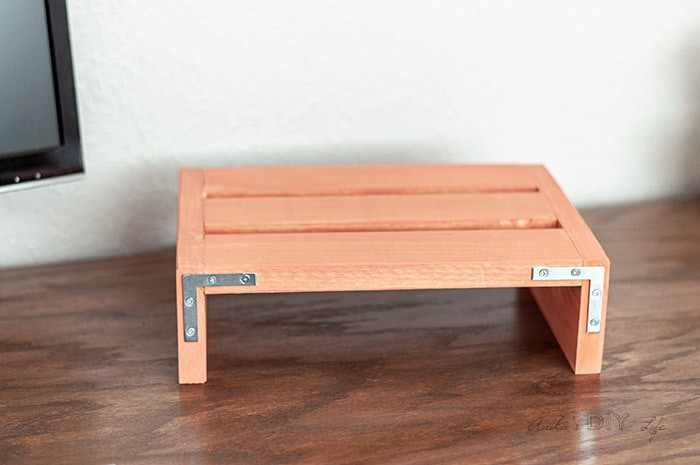 Painted laptop desk stand with metal corner braces for an industrial accent