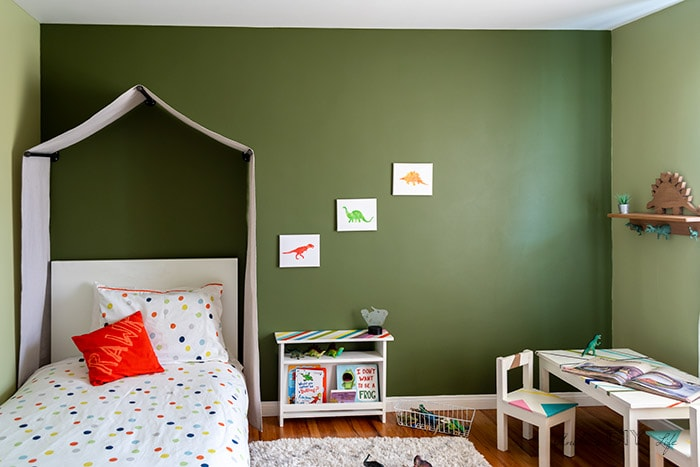 Kids room with DIY tent canopy and nature theme