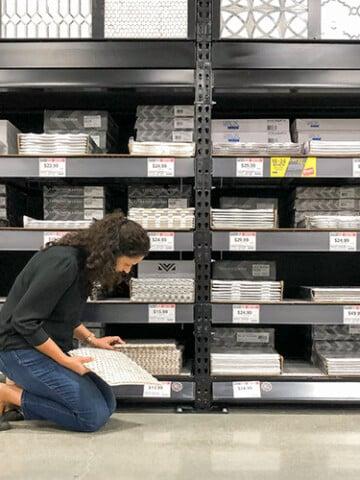 woman looking at tiles