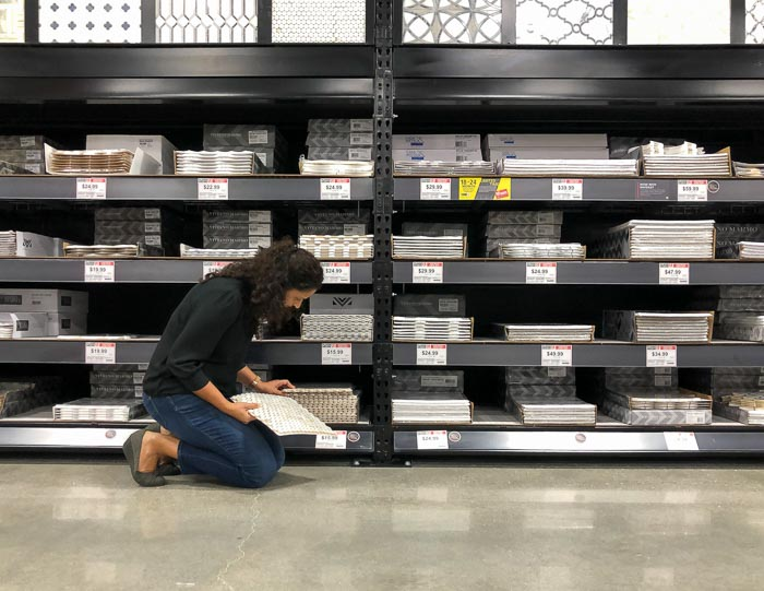 woman looking at tiles