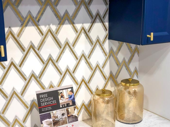 close up of navy blue and gold and white tile