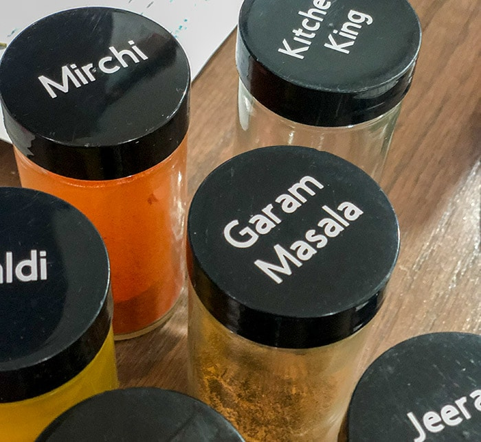 labeled indian spice jars