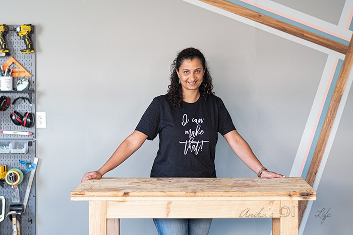woman standing in workshop with painted accent wall
