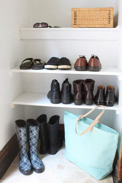 built-in shoe shelves in a closet
