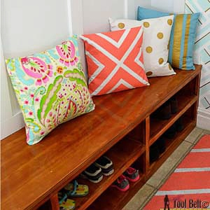 shoe storage bench with shelves in mudroom