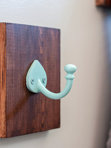 These DIY bathroom towel hooks are a really simple and quick 15-minute upgrade project for your bathroom. Replace an existing towel bar or add new storage with style!