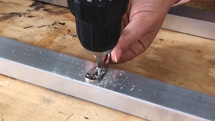 Adding hooks to the aluminum coat rack