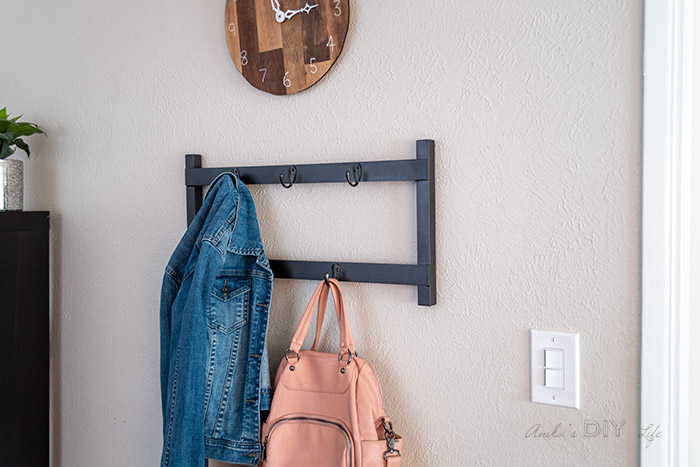 DIY metal coat rack with jacket and bag hanging