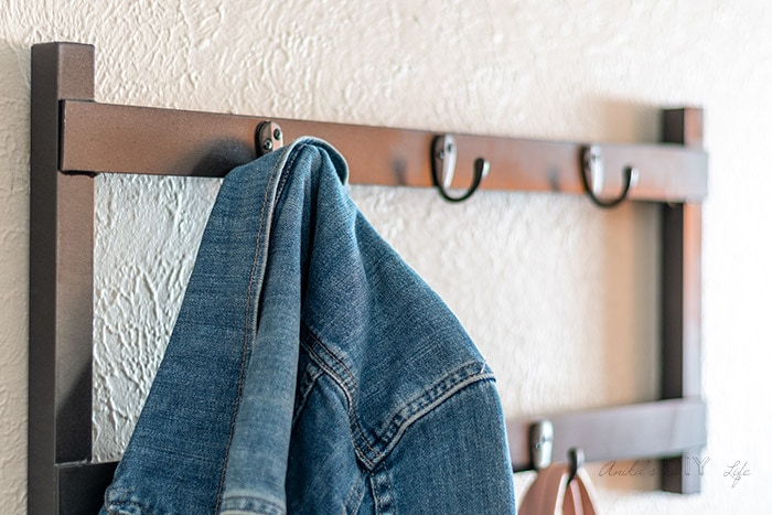 close up of jacket hanging on a DIY metal coat rack