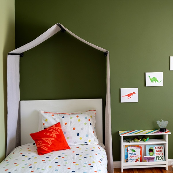 Learn how to make a no-sew canvas DIY canopy tent for over the bed with this quick tutorial. Perfect for any nature-themed or little boy's room or playroom.