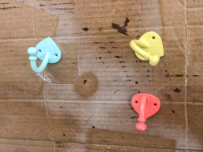 Spray painted hooks in blue, yellow and coral