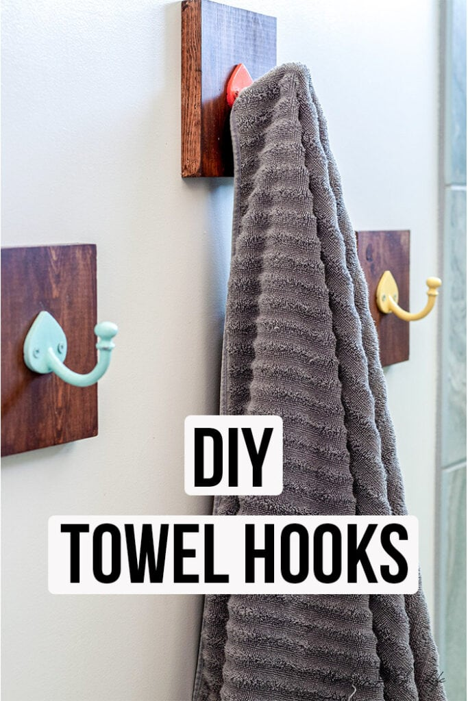 DIY Bathroom towel hooks with towel hanging and text overlay