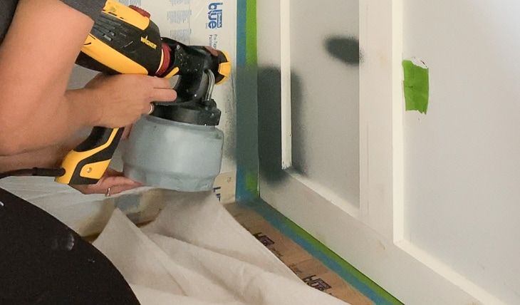painting a board and batten wall using a paint sprayer