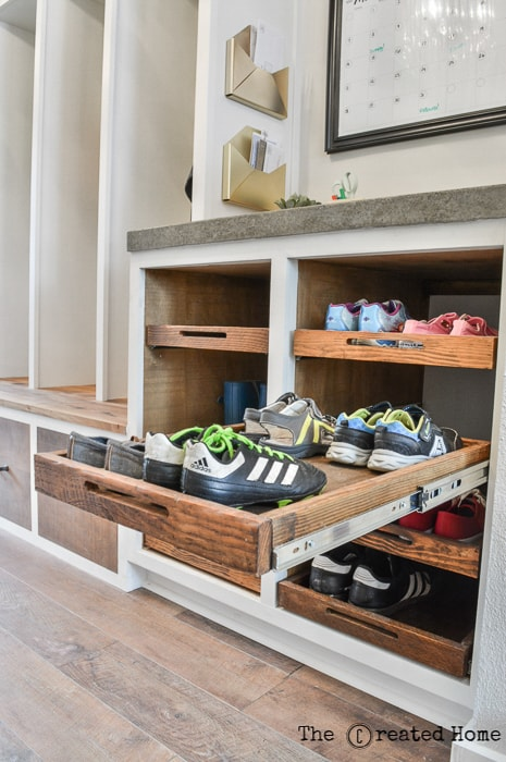 mudroom builtins with shoe trays