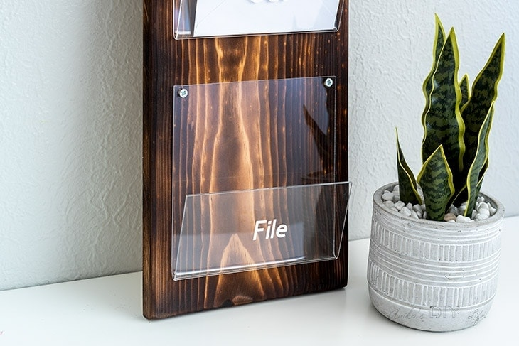 close up of bent acrylic and wood mail organizer