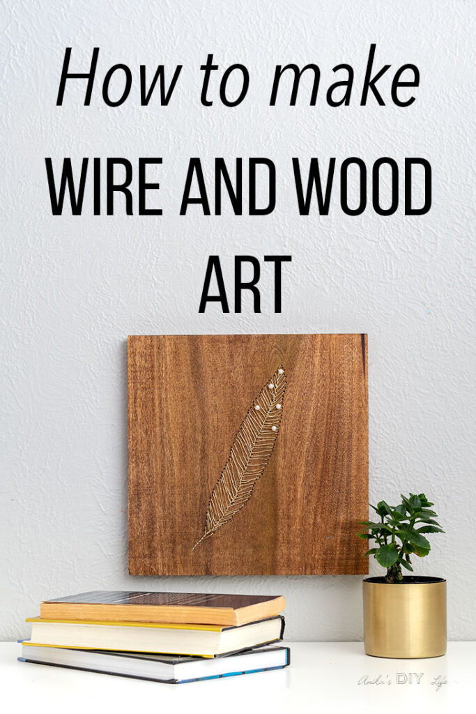 DIY wire and wood art on wall with books and plants