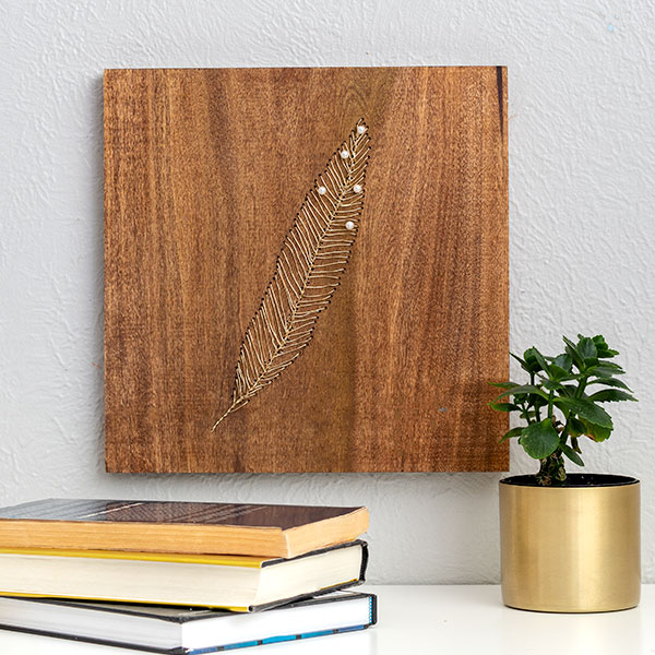 Learn to make this creative and stunning DIY wood wall art using gold wire. It's like embroidery on wood and so easy to make!