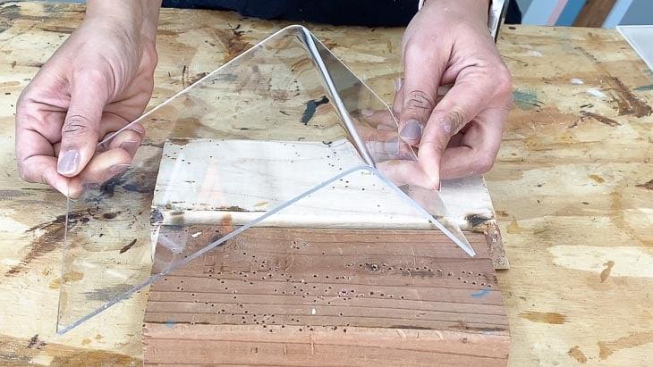 bending the piece of plexiglass
