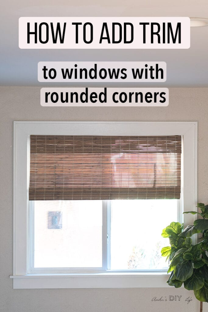 Window with DIY window trim and text overlay