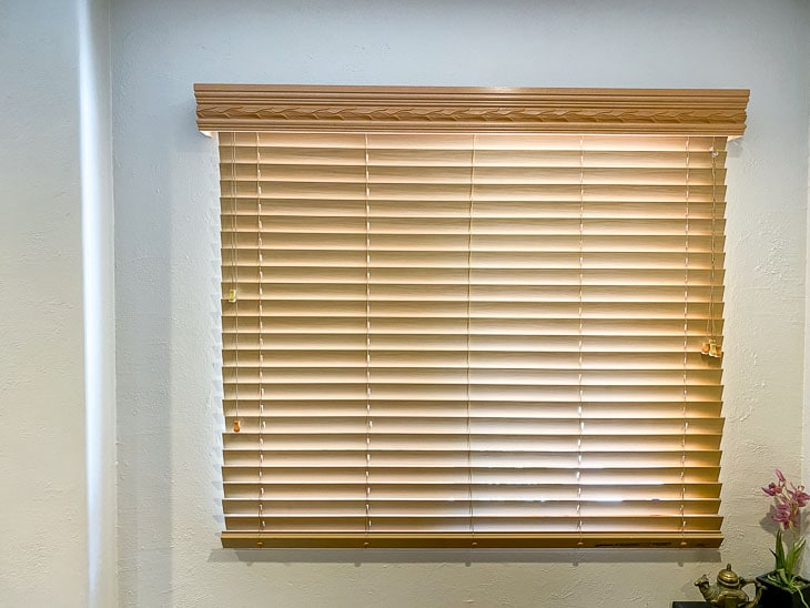 Window with old brown blinds